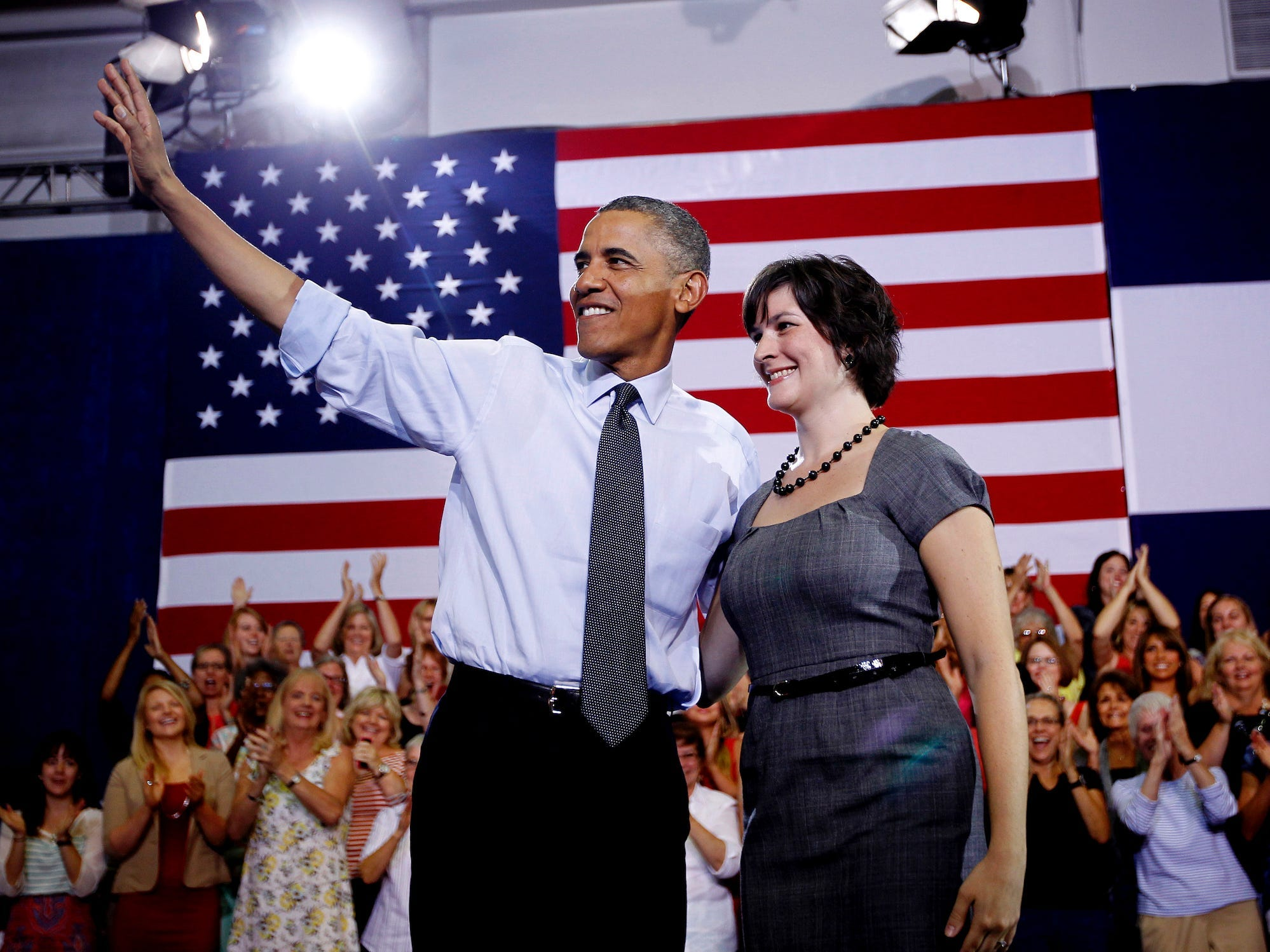President Barack Obama, accompanied by Sandra Fluke, waves at a campaign event at the University of Colorado Auraria Events Center, Wednesday, Aug. 8, 2012,