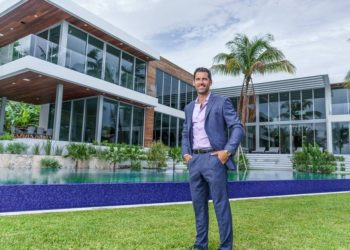 A day in the life of Miami broker Chad Carroll, who is juggling a 'tenfold' jump in luxury home inquiries as hordes flee to Florida